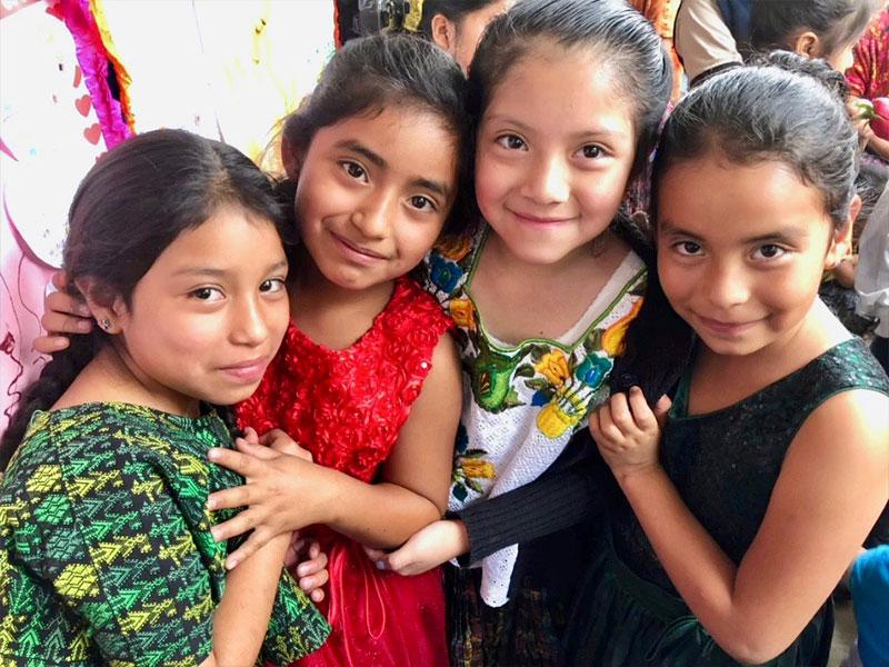 Four young guatemalan girls smiling