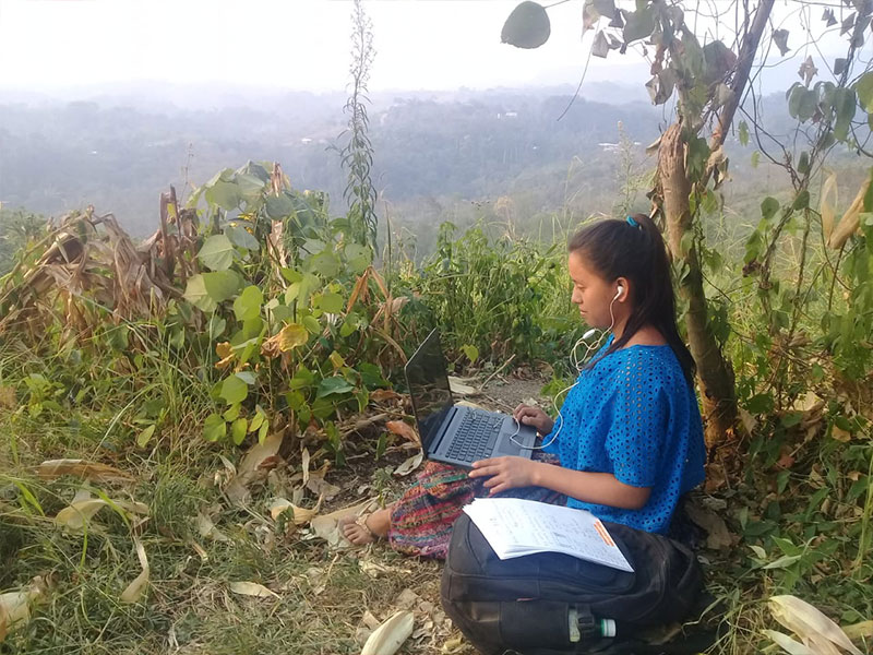 Guatemalan student studying virtually from a mountaintop