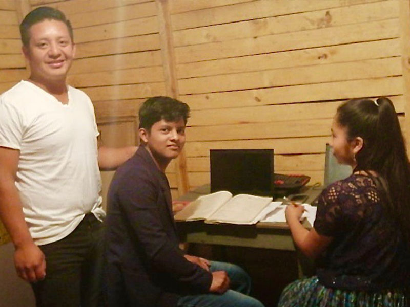 Guatemalan internet cafe with young student studying virutally